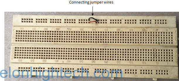 Figure 11: The separated rails of a breadboard joined with a jumper wires